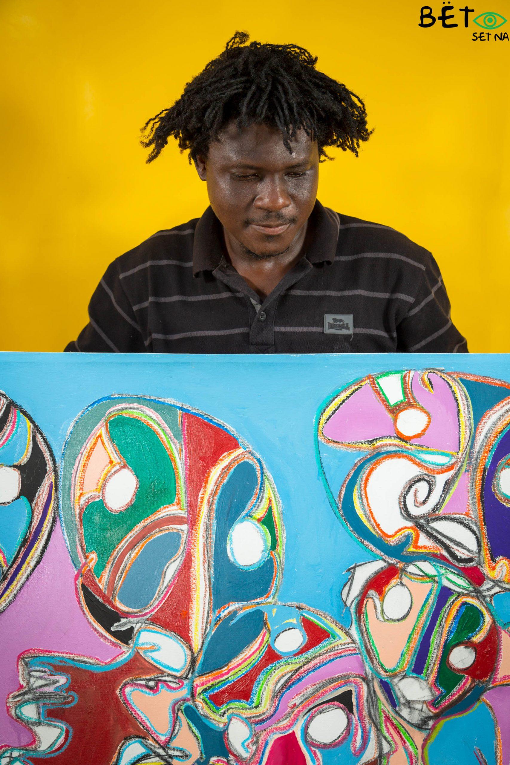 Kwami Da Costa avec son oeuvre